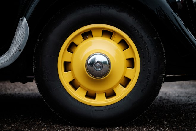 tire with bright yellow hubcap